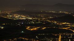 Time lapse of night life in city surrounded by mountains - stock footage