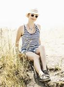 Young caucasian woman in a sailor outfit, sunlight Stock Photos