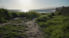 Peaceful path leading to beach near Point Conception State Marine Reserve Stock Footage