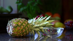 Freshly Cut Pineapple Falling Into Bowl On Kitchen Counter Stock Footage