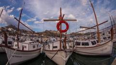 4k pollenca port harbour fishing boats coast sea mallorca Stock Footage