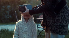 A cute little girl watching 360 degree cartoon Stock Footage