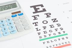 Table for eyesight test with calculator over it Stock Photos