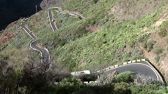 Passenger bus by company Titsa drives on mountain road TF-436, Tenerife, Canary Stock Footage