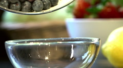 Pouring Fresh Ripe Blueberries Into A Bowl In Kitchen Stock Footage