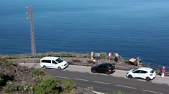 Cars are parked on roadside for viewing from mirador, Garachico,Tenerife, Canary Stock Footage