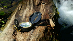 Compass on the wood near little stream Stock Footage