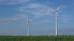 Wind turbines standing in a field Stock Footage
