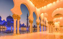 Sheikh Zayed Grand Mosque at dusk in Abu Dhabi, UAE - stock photo