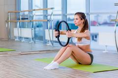 Pilates woman magic ring exercise workout at gym indoor Stock Photos