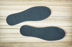 New shoe insoles on the wooden background Stock Photos