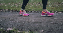 Woman wearing bright pink running shoes Stock Footage