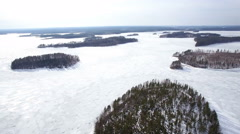 Aerial landscape of a frozen lake with lateral movement Stock Footage
