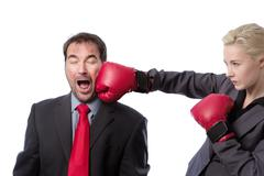 Business man punch to the head Stock Photos