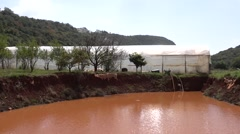 Stock Video Footage of Water reservoir and green house 2