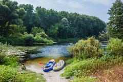 Boy kayaking on the river - stock photo