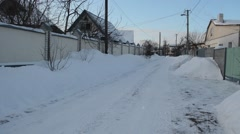 Street in small cottage settlements in winter frosty and sunny day. Stock Footage