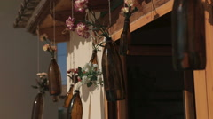 Decorations for wedding, hanging jars with fresh flowers inside. Stock Footage
