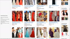 computer user choose evening dress on eBay website - stock footage