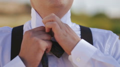 Man putting on bow tie. Stock Footage