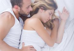 Admiring sleeping wife - stock photo