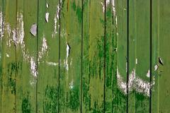 Dirty, stained by a paint the hammered together fence Stock Photos