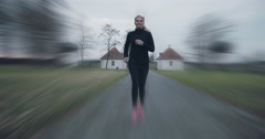 Woman running at speed towards the camera Arkistovideo