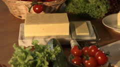 Roughly Slicing A Block Of Cheese In Kitchen Stock Footage