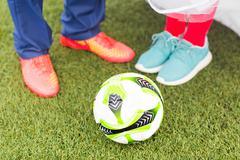 European Football Championship concept. Man and woman on the football stadium - stock photo