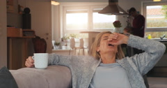 Attractive woman taking a break at home Stock Footage
