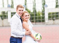 European Football Championship concept. Wedding couple on the football stadium - stock photo