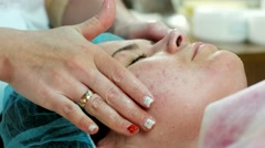 Facial massage reducing oil patient with skin problems. Stock Footage