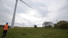 Engineer Inspecting large Wind Turbine Stock Footage