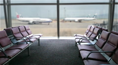 Close-up chairs in the airport, on the background of a moving airplane. - stock footage