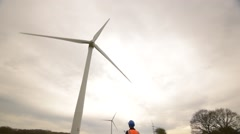 Engineer Inspects a large Wind Turbine Stock Footage