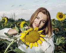 Beautiful woman posing in sunflower field, beauty and nature Stock Photos