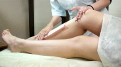 Removing hair from the legs with hot wax. Stock Footage