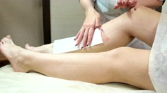 Women legs and hair removal with hot wax painful procedure. Stock Footage