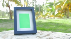 Picture frame with greenscreen product shot with tropical background 3 - stock footage