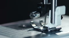 Equipment at textile factory. Closeup. Industrial sewing machine working Stock Footage