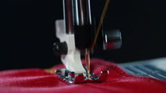 Sewing machine stitching seam on fabric. Yellow thread pattern on red fabric Stock Footage