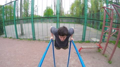 Man Working Out Push-Ups On The Parallel Bars. - stock footage