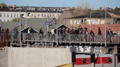People walking over bridge at train station in berlin, germany Stock Footage