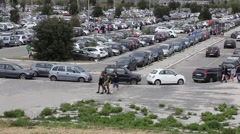 Parking lot with people walking Stock Footage