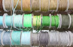 Many colored ribbons for sale per meter in the wholesaler's shop of articles Stock Photos