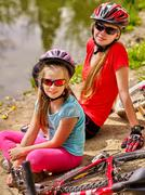 Bikes cycling family. Happy mother and daughter  rides bicycle. Stock Photos