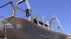 Welder working on new ship construction Stock Footage