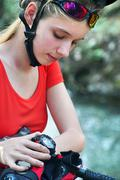 Bikes cycling girl. Bicyclist girl watch on watches. - stock photo