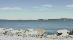 Fort Gorges in Casco Bay wth boat crossing frame Stock Footage