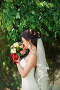 Beautiful bride on the nature Stock Photos